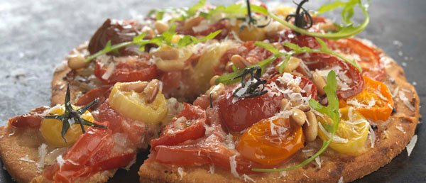 Heritage tomato, honey and mustard onion polenta tart