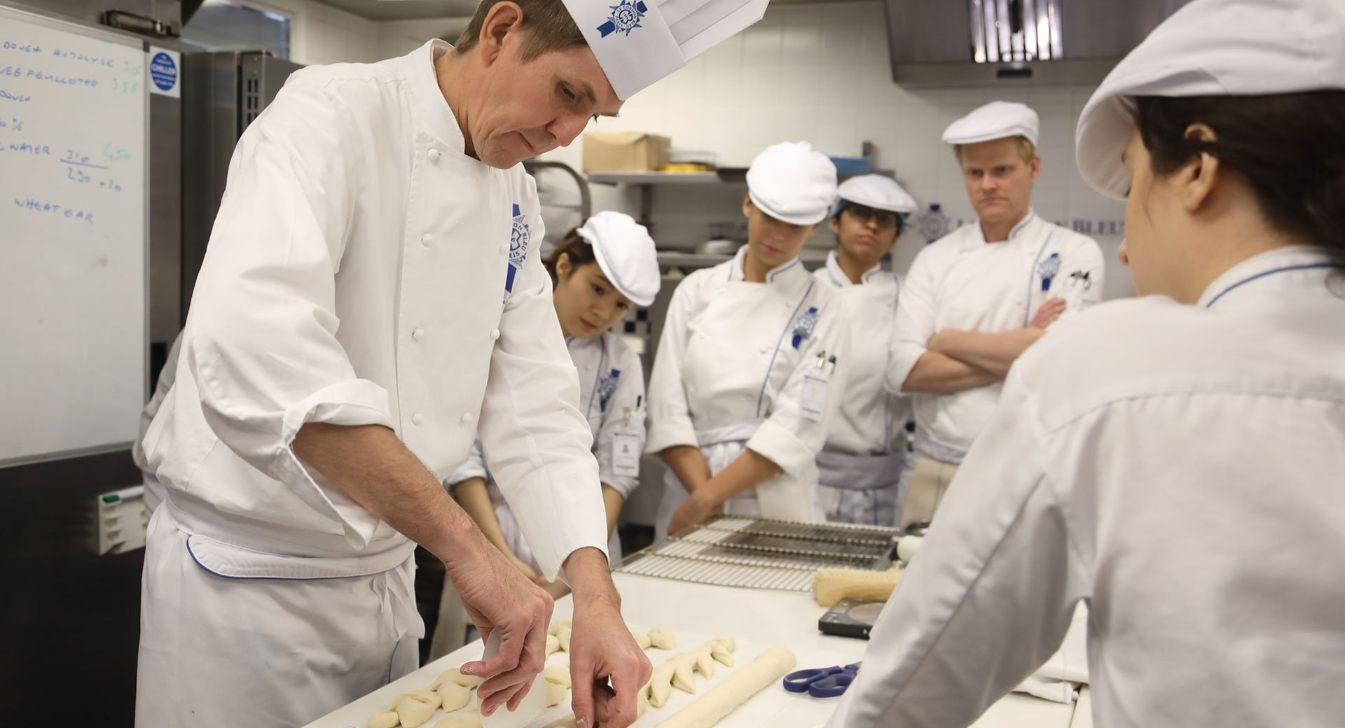 chef dominique moudart with boulangerie students at le cordon bleu london