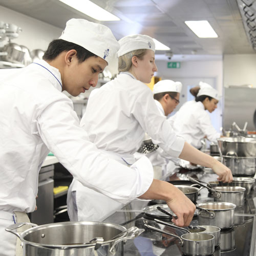 Le Cordon Bleu students in the kitchen