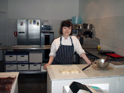 Jun Sun in her kitchen