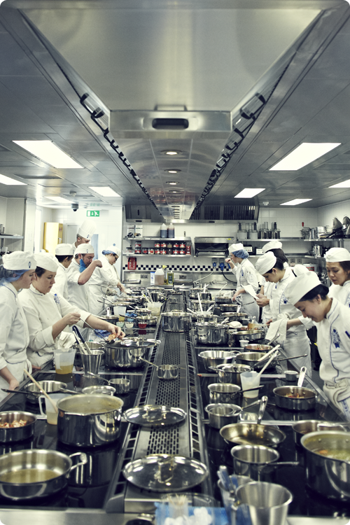 Facilities at Le Cordon Bleu London - students in the kitchen